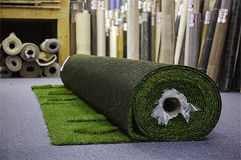 Image of our showroom and partially rolled out artificial grass Plymouth