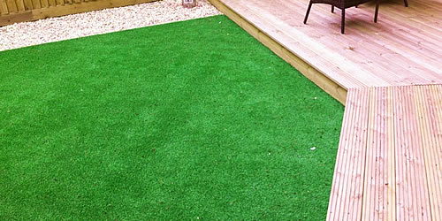 Budget artificial grass simply carpets plymouth for Garden decking with artificial grass